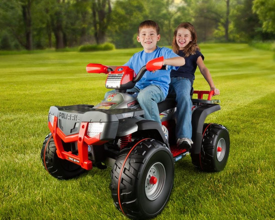 Peg Perego - Peg Perego Polaris Sportsman XP850 ATV Battery Powered Riding Toy - Red Multicol - Shop for Games & Puzzles from Hayneedle.com! Conquer grass dirt and hard terrain from the comfort of the Peg Perego Polaris Sportsman XP850 Battery Powered Riding Toy. Four-wheel shock-absorbing suspension a high-output 24-volt rechargeable battery and variable speed control are among this riding toy's ATV-like features. About Peg PeregoAfter the birth of his infant son in 1949 Giuseppe Perego was unhappy with the minimal selection of juvenile products and decided to design his own baby carriage. His wife added beautiful functional fabrics and the overall aesthetics caught the attention of other parents in the Peregos' small Italian neighborhood. They were inundated with requests by neighbors for carriages of their own and Peg Perego was born. Before long the company introduced high chairs strollers and other juvenile products. With each new product the family commitment to quality continued. Always thinking forward Peg Perego has never rested on past products or designs; it continues to stay current with parents' changing needs and new research that highlights the health and safety of infants and juveniles.