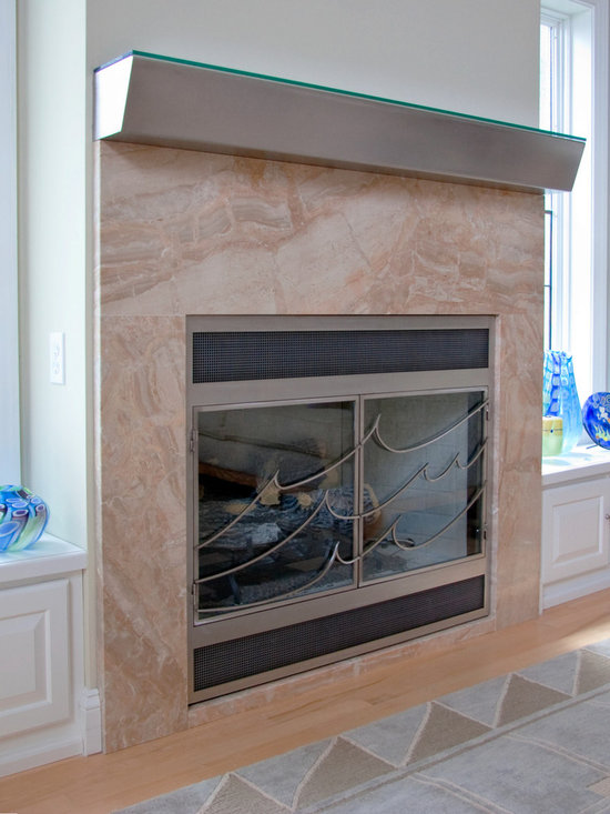 Modern Fireplace Surrounds - We work with you to remake your fireplace surround become a statement in your room.