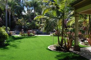 Residential features tropical landscape orange for Landscaping rocks daytona beach