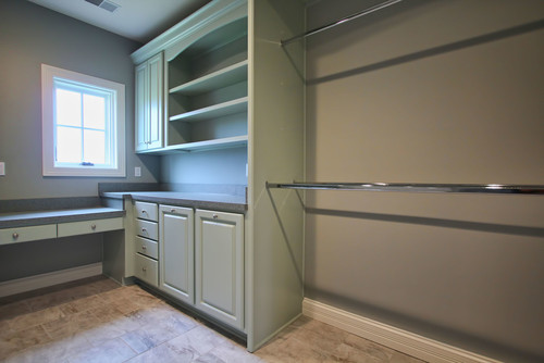 Check out this pimped out laundry room! Drying racks, sewing desk, front loaders, and more.....