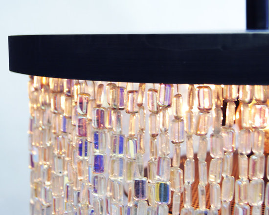 Harna - Crafted from over a thousand individually hung glass beads, the Harna chandelier captures the eye by refracting direct and ambient light into a spectral array of kaleidoscoping colors.