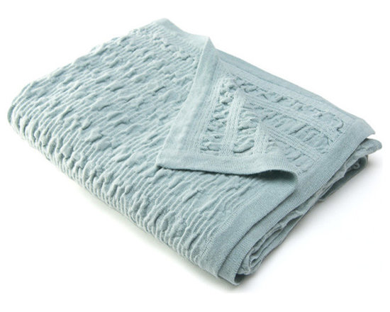 Sefte Living - Sefte Kai Woven Throw Mist - Kai, meaning water in the ancient Quechua language, draws inspiration from the sea. The weave is meant to represent the ripples and waves of the water as it meets the shore. It has a soft spongy hand and a gathered weave structure.