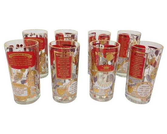 Used Red & Gold Highball Glasses - Set of 8 - A set of 8 vintage highball glasses from the 1960s, featuring drink recipes and gold rims. Each glass has 5 different drink recipes and are in excellent condition. These are the perfect pop of red of your holiday bar cart!    The seller has other bar items available in this same pattern, including 8 old fashioned glasses and an accessories set that includes an ice bucket, cocktail shaker and ashtray. If you're interested in purchasing the entire set, please email: support@chairish.com.