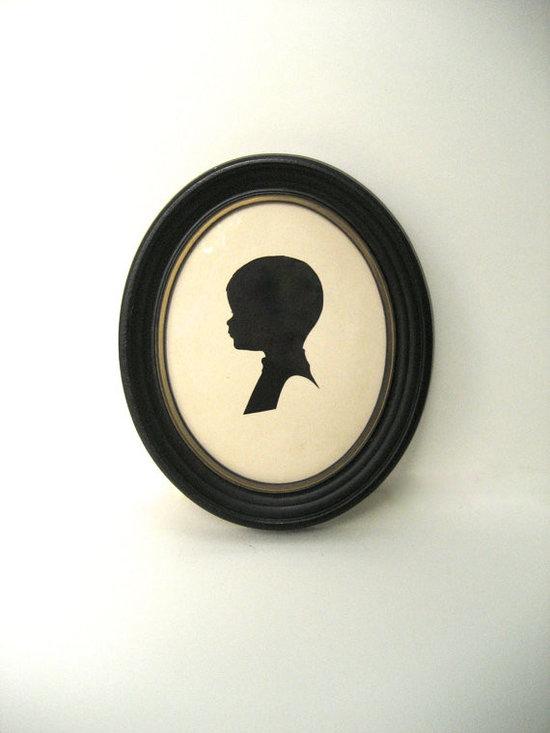 Baby Silhouette Paper Cut Toddler Boy in Black Oval Frame by Elsa Bronte Vintage -