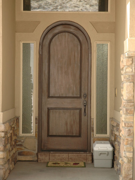 Lifestyle Pictures - Krosswood Doors - Solid wood round top door giving new lines and distinction to your home.