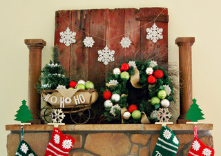a wreath on a mantel is a wonderful way to fill your room with glee