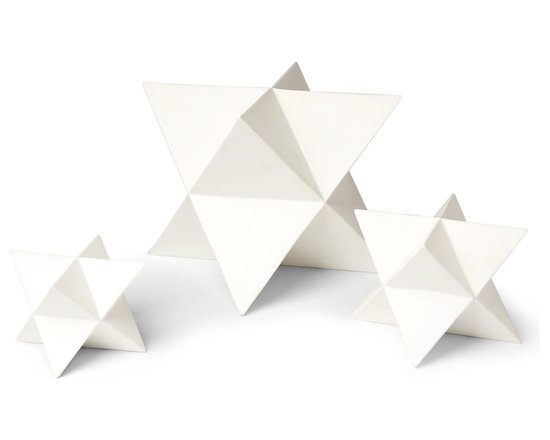 Kathy Kuo Home - Orion White Ceramic Polyhedron Stars - Set of 3 - Playful and polished, this set of three ceramic stars evokes origami artwork. Polished white, the daring, precise geometric lines add an architectural element to any collection. They make a bold statement on any end table, shelf or bookcase.