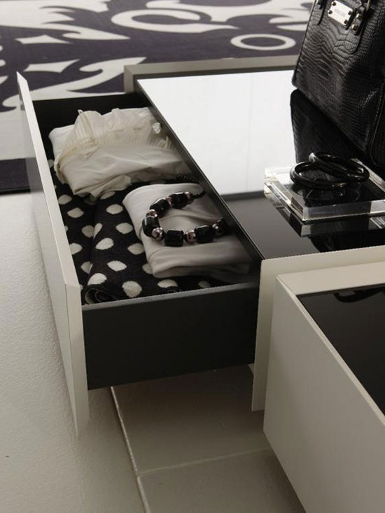 Secret Designer Nightstand By Rossetto - Whimsical imagination is at the heart of the Secret Designer Nightstand. It features a contrasting white lacquer finish and black glass top. Stylish and beautiful,the nightstand is a fine example of Italian workmanship and high functionality.