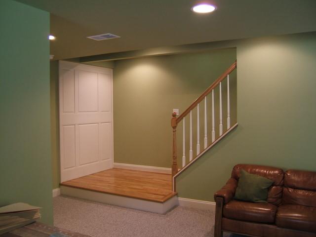 custom staircase landing and wall raised paneling modern basement