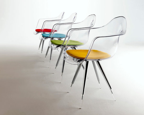 """Angel Armchair by Kubikoff - Angel chair with a basic structure and a very refined simplicity. The combination between the chromium-plated part and the acrylic part of the legs creates a curious """"suspended"""" effect, increased by the possible use, for chair and armchair, of a shell in transparent polycarbonate. Seatpads are available in various colors. Also available in leather"""