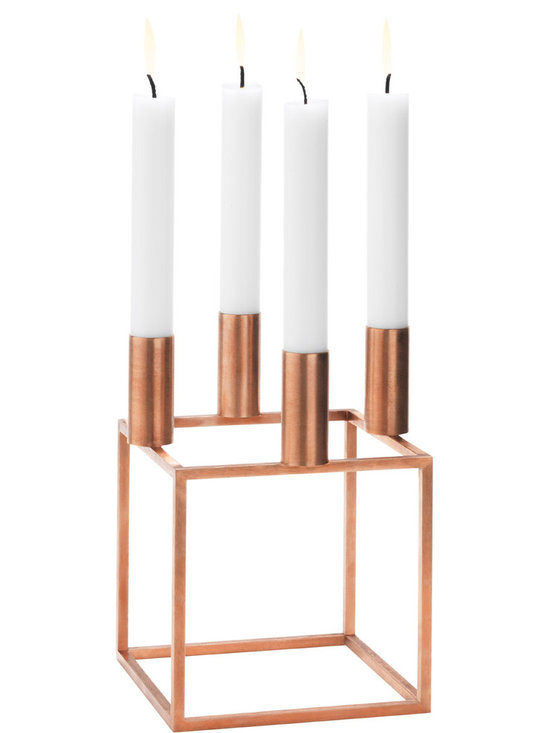 By Lassen - Kubus 4 Candle Holder - Copper - By Lassen - Introduced in 1962 by Mogens Lassen, the Kubus collection represents his lifelong devotion to the Bauhaus ideal of functionalism, where rationalism trounces the merely ornamental. The collection is also a fine example of his craftsman's appreciation of materials. Here, he uses the copper plated steel to heighten the simplicity and strength of the Kubus collection. A prolific designer and architect, Mogens was as equally adept at creating pieces to include in the buildings as he was designing them, and has left a rich archive still being discovered by design fans today.
