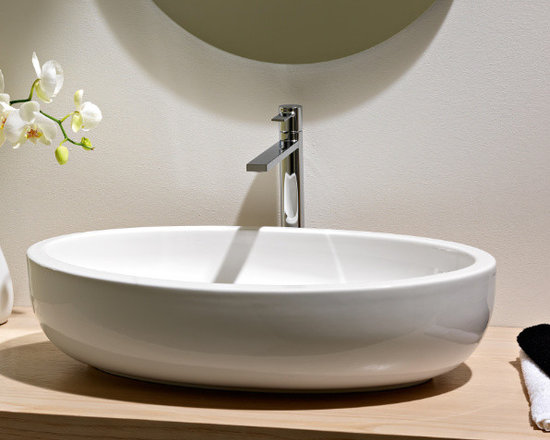 "Scarabeo - Beautiful Oval Above Counter Vessel Bathroom Sink by Scarabeo - Beautiful contemporary bathroom sink made of white ceramic. This oval shaped above counter vessel sink comes without overflow and has no faucet hole. Designed and manufactured in Italy by Scarabeo. Sink dimensions: 26.00"" (width), 6.30"" (height), 15.20"" (depth)"