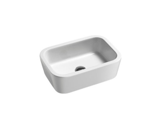 "GSI - Simplistic Curved White Ceramic Vessel Sink by GSI - This contemporary white ceramic bathroom sink has a very simple rectangular design. Made in Italy by GSI. Above counter curved vessel sink comes without overflow and has no faucet holes. Sink dimensions: 20.50"" (width), 6.50"" (height), 14.20"" (depth)"