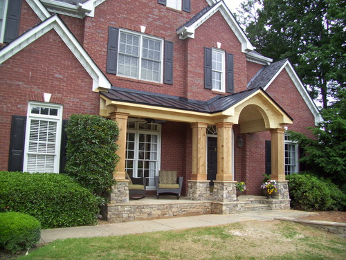 Unpainted Front Porch Addition To Traditional Brick Home