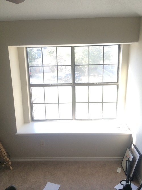 how should i hang curtains on this window seat