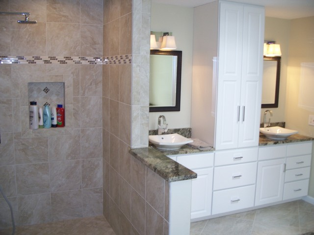 White cabinets, granite tops with vessel bowls.