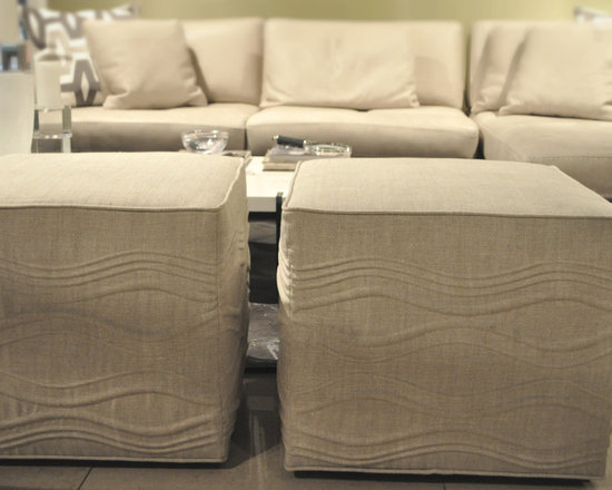 Showroom Pieces - Ottomans in a waved oatmeal fabric are now on our floor.