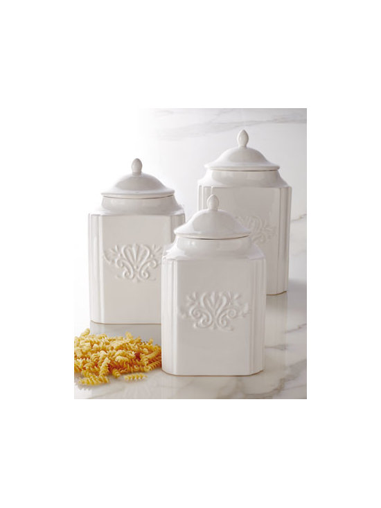 "NM EXCLUSIVE - NM EXCLUSIVE Three ""Emblem"" Canisters - Exclusively ours. Canted corners, dome lids, and an embossed emblem design lend style and substance to these classic white canisters. Made of earthenware. Dishwasher safe but hand washing is recommended. Microwave safe. Small, approximately 6.25""Sq. x 10.5""T; holds 64 ounces. Medium, approxim"