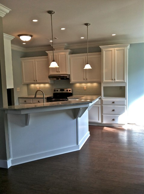 White Cabinets w/ Angled Peninsula traditional-kitchen-cabinets