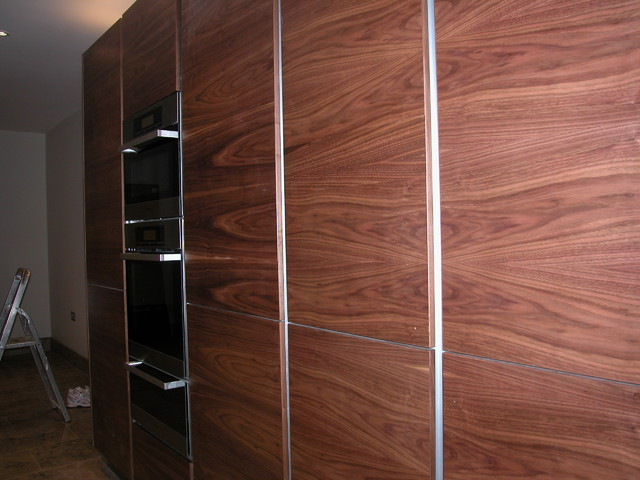 Handle-less kitchen, book-matched Walnut contemporary-kitchen