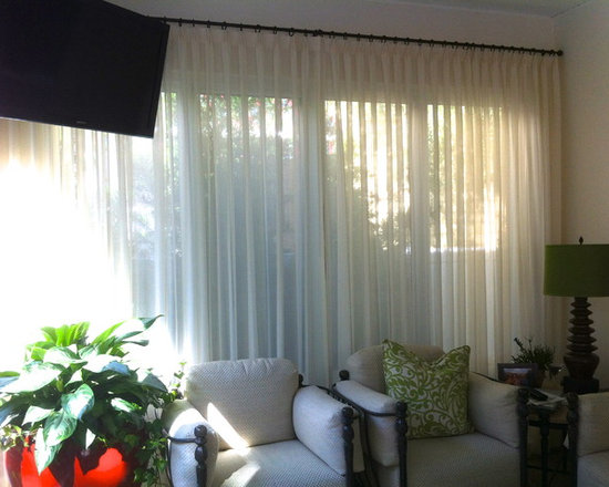 Sunroom - Functioning sheers on a wrought iron pole.  Design by Michael Meloy.  Installation by Curtain Pros.