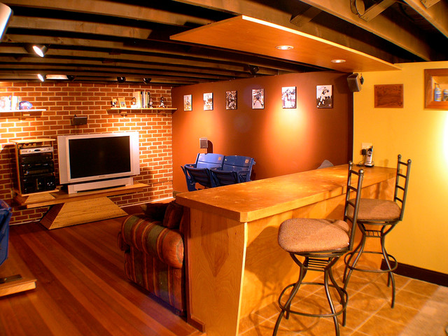 Sports themed man cave eclectic basement Man cave ideas unfinished basement