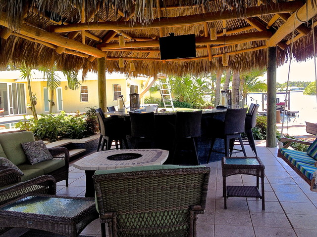 Tiki hut outdoor kitchen and landscaping tropical miami by bamboo landscaping and