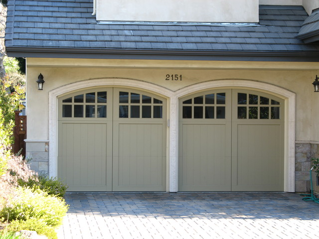 Carriage house painted garage doors traditional garage for Painted garage doors pictures