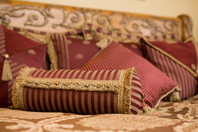 Burgundy and gold custom pillows with fringe and tassels for Burgundy and gold bedroom designs