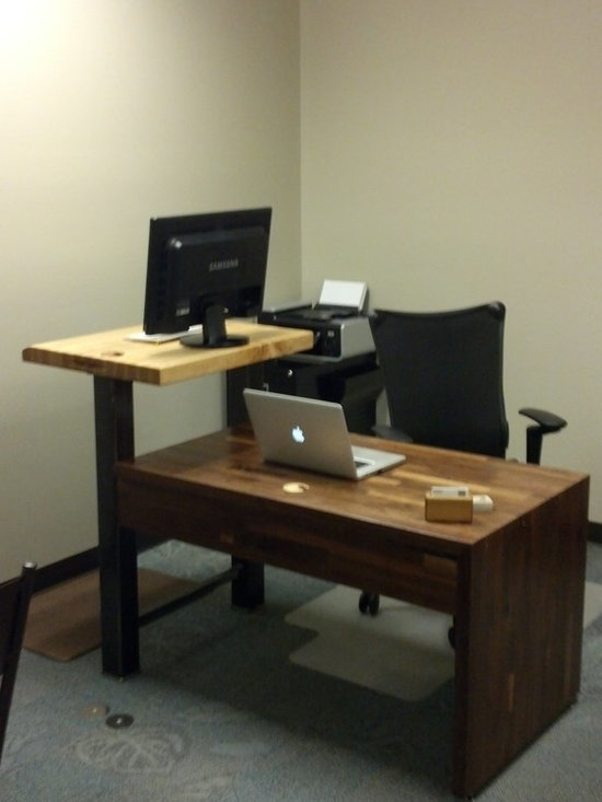 """The Stallion"" Sitting/Standing Workstation - This piece was custom designed as a desk for an office space, though - with slight modifications - it could be just as at-home in a kitchen. It incorporates both standing and seated workstations. The lower, sitting desk is fashioned from 1.5"" thick, black walnut Boos, Inc. butcher block, while the upper desk is a piece of 2.25"" thick maple Boos, Inc. butcher block. The uprights of the standing desk, which also act as one set of legs for the lower desk, are constructed of 3.5"" square steel tubing. One of these square tubes also acts as a chase for cables, allowing neat, organized connections between the monitor, laptop, data ports, and power supply."