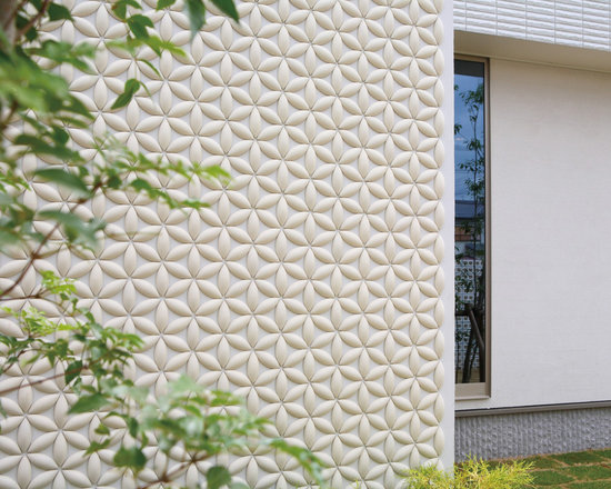 Japanese Stoneware Wall Screens - These exquisitely designed wall screens and dimensional features are made in Japan by Kowa with molded and extruded stoneware. Stoneware is a very strong type of ceramic that lends itself to precise manufacturing, following the Japanese tradition of simple, elegant design. Fixed with metal dowel, the screens create semi-private spaces that allow for the circulation of light and air. Other features are installed as tile or applied with glue on finished surfaces as dimensional patterns.