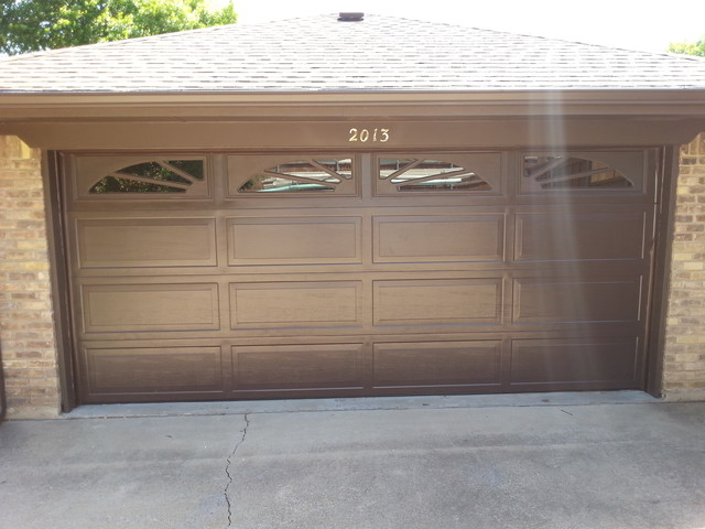 Double steelback garage door with windows and inserts for A1 affordable garage door