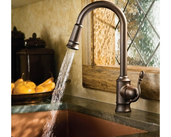 Moen Woodmere Classic stainless one-handle high arc pulldown kitchen faucet - Woodmere's flowing design provides an uncluttered appearance to your countertop. The exclusive patented pause button easily suspends water flow from the wand.