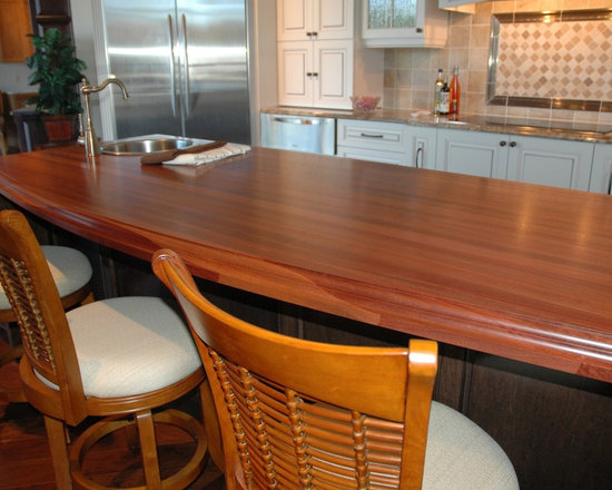 Custom Mahogany Wood Countertop - 2-1/4″ thick Edge Grain Santos Mahogany Kitchen Island with a Conventional Double Roman Ogee on top of three sides, Square bottom and vertical edges and a Durata® waterproof permanent finish in satin. Designed by Quality Design Works, Inc.