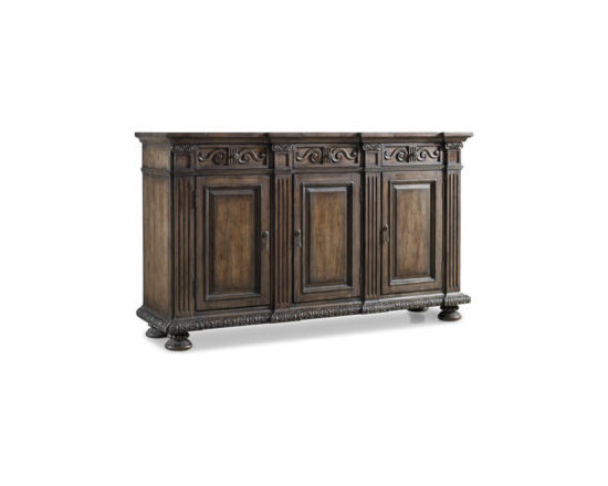 Horchow - Donabella Credenza - Gorgeous details such as fluted pilasters, ornate scrollwork, and intricate carvings highlight this updated antique-style credenza, adding a stunning face to its elegant silhouette. With three drawers and shelving behind the doors, it offers ample stora...