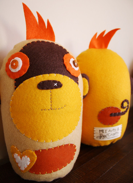 BOObeloobie Mango the Monkey in Yellow, Orange, Chocolate brown and White accent contemporary-decorative-pillows