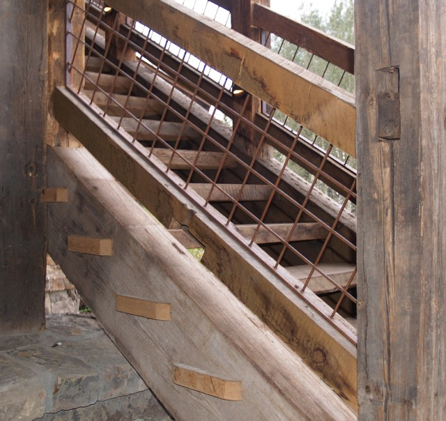 Reclaimed lumber timber stairwell rustic staircase for Reclaimed wood suppliers