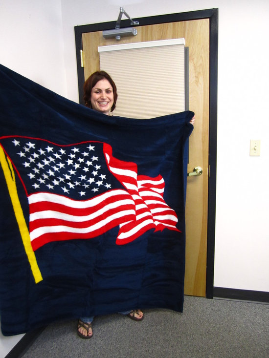 Michelle in front of one of our Symphony Shades. - Michelle in front of our cordless shade with a American Flag blanket by Draper Knitting in MA.