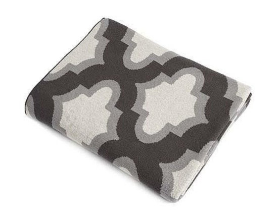Belle & June - Grey Symbols Cotton Blanket - Divine symmetry defines the bold symbolism woven into this soft cotton throw. Poised in neutral colors, it can serve as a cloak while sipping hot cocoa on the sofa, a comfy cape as you curl up with a good book in bed, or a stylish stand-by ready for use while draped on your favorite chair.