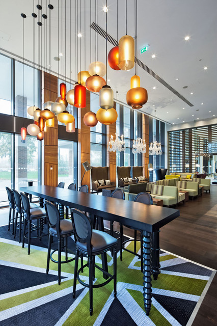 Niche modern pendant lighting at the t5 hilton at heathrow for Dining room 3 pendant lights