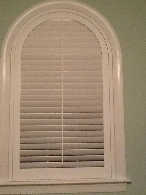 arched wood interior plantation shutter
