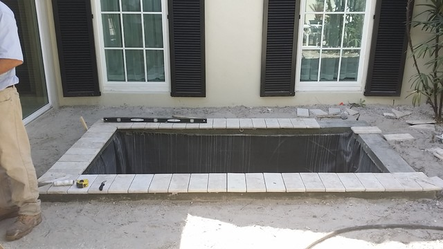 Formal Koi Pond With Natural Stone Walkway And Border