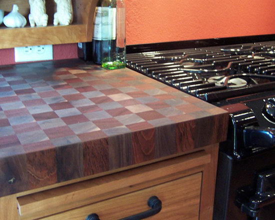 Cherry and Walnut Butcherblock Countertop by Grothouse - 2-1/2 inch Brazilian Cherry and Walnut Checkerboard Butcherblock Countertop in brown and red colors with 1/8 inch Roundover edge profile and a Food Grade Oil finish. Photography courtesy of Grothouse Lumber Co.