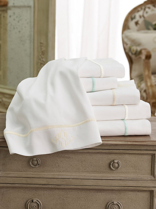 Luxury Sateen Sheet Set - The softest Portuguese cotton sateen is elegantly accented with a simple embroidery to create a little luxury for any bed. Set includes 1 flat sheet, 1 fitted sheet, 2 pillowcases. Available in 3 colors of embroidery: white, natural, and spa.