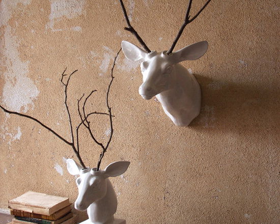 """Ceramic Deer with Holes For Antlers - Quite possibly the easiest DIY project ever tackled. Choose the wall hung or table top white ceramic deer mount that best suits its lodging and arrange your own """"antlers"""" in the spaces provided. Be bold, be simple, and be creative!"""
