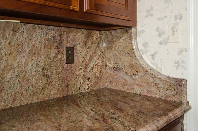 crema bordeaux granite with full backsplash traditional