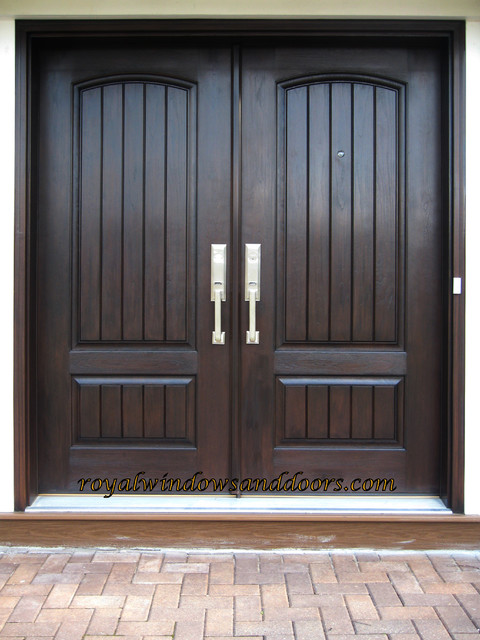 Double entry door system fiberglass with wrought iron for Houses with double front doors