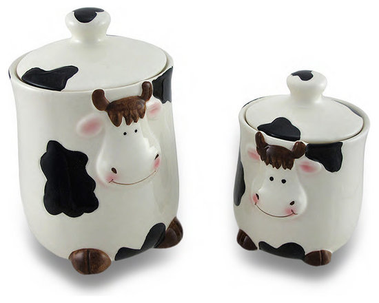 Zeckos - Set of 2 Black and White Cows Ceramic Jars w/Lids - Perfect for storing small snacks, sugar for coffee or tea, or just as a decorative accent, this set of 2 jars feature a black and white cow print, cow faces and front hooves. Made from ceramic, this large jar measures 6 inches high, 4 inches diameter (15 X 10 cm) while the smaller jar stands 4.5 inches high and 3.25 inches diameter (11 X 8 cm), and each includes a ceramic lid. They'll look amazing whether on the counter, the coffee bar or a shelf, and they'd make a wonderful gift any cow collector would be proud to own