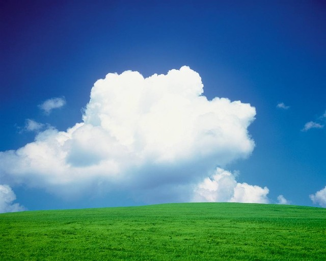 Clouds over a grassland panoramic fabric wall mural for Clouds wall mural