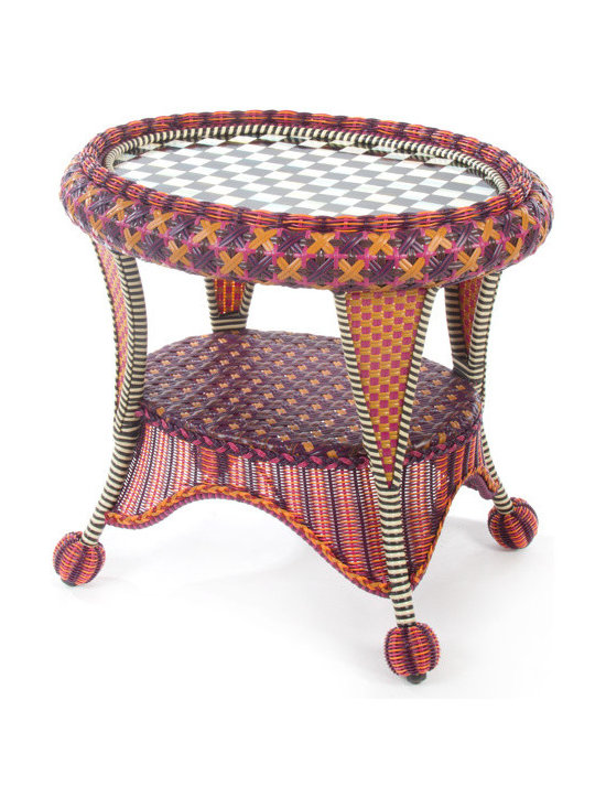 Sunset Outdoor End Table | MacKenzie-Childs - Exotic yet familiar, the Sunset Outdoor Collection can instantly turn any terrace or porch into a luxurious retreat. Rich golds, oranges, purples, and blues, with flashes of magenta, recall blazing summer sunsets over Cayuga Lake. Hand-woven resin wicker is as durable and comfortable as it is striking.